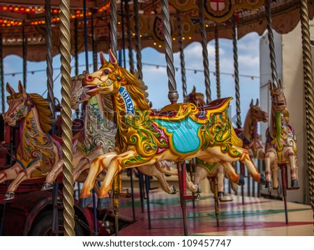 billy the carrousel horse on fairground ride - stock photo