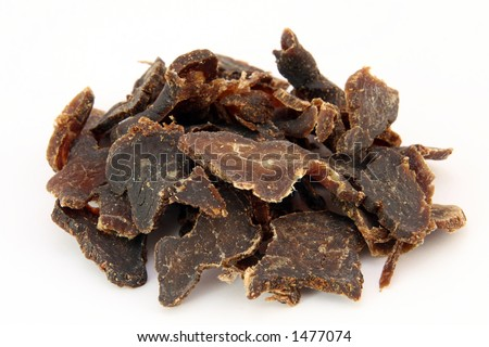 Biltong is a healthy low fat, high protein cured dry meat suitable for dieting using sun dried methods of food preservation, isolated on white, shallow dof, macro, close up, on white - stock photo