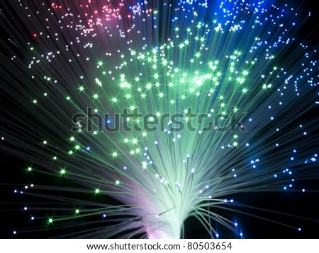 binary code data flowing through optical wires - stock photo