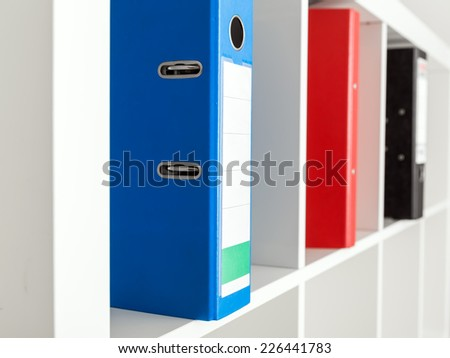 binder stands on the shelf  - stock photo