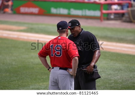 BINGHAMTON, NY - JULY 7: Portland Sea Dogs manager Kevin Boles has a discussion with the umpire in a game against the Binghamton Mets at NYSEG Stadium on July 7, 2011 in Binghamton, NY - stock photo