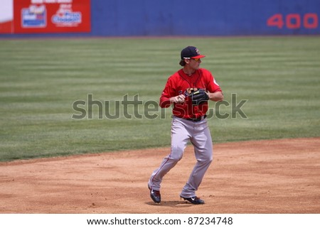 BINGHAMTON, NY - JULY 7: Portland Sea Dogs  third baseman Will Middlebrooks  throws a runner out during a game against the Binghamton Mets at NYSEG Stadium on July 7, 2011 in Binghamton, NY - stock photo