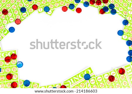 bingo card and chip arrange to have center space background isolated on white background - stock photo