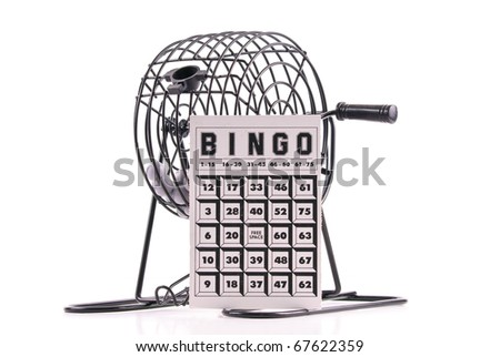 Bingo Card on Bingo Ball Cage - stock photo