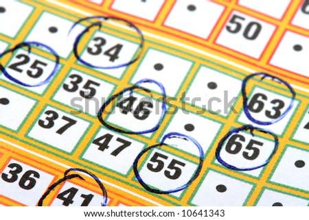Bingo card with circled numbers - stock photo