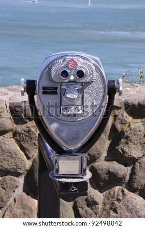 binocular next to the waterside promenade in San Francisco - stock photo