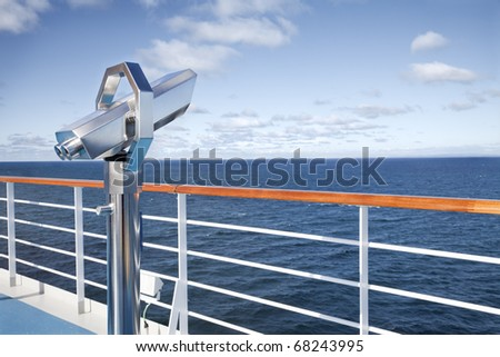 Binoculars looking  at the horizon on the deck of cruise - stock photo