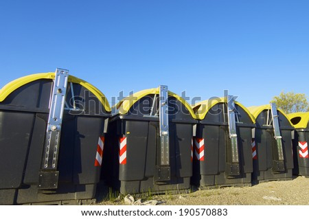 Bins group for plastic recycling and blue sky - stock photo