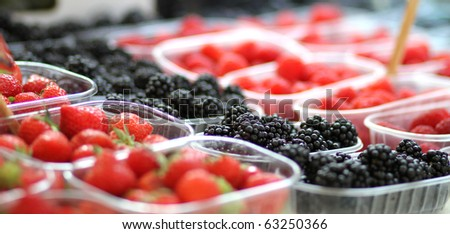 bio berries at the farmer's market - stock photo