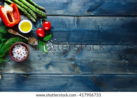 Bio colorful vegetables ingredients for tasty vegan and diet cooking or salad making on rustic wooden background, top view. Vegetarian food concept. - stock photo
