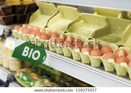 Bio sign with eggs in the background - stock photo