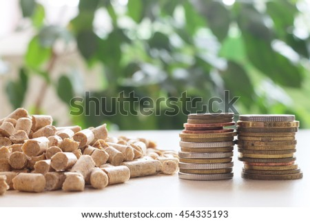 Biofuels, Eco fuel . Alternative biofuel from sawdust for burning in furnaces. Wood pellets for stoves. The cat litter.The concept of savings when using eco materials. - stock photo