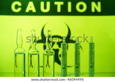 Biohazard sign and ampules with syringes - stock photo