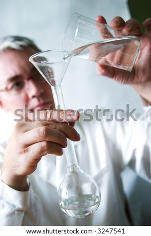 biological test of the water. Soft-focused, focal point is on the hands - stock photo