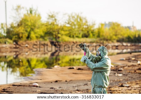 Biologist testing quality of natural water - stock photo