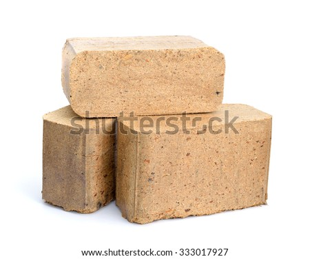 Biomass briquettes are a biofuel substitute to coal and charcoal. Isolated on white background. - stock photo