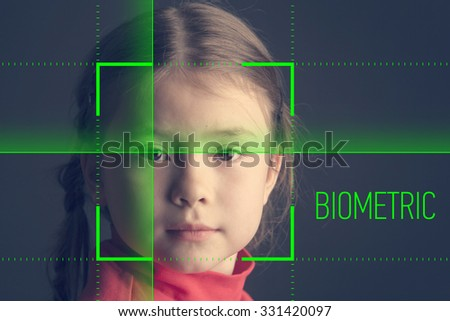 Biometric verification - small girl face recognition - stock photo