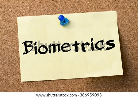 Biometrics - adhesive label pinned on bulletin board - horizontal image - stock photo