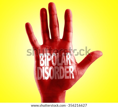 Bipolar Disorder written on hand with yellow background - stock photo