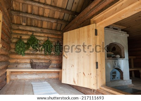 Birch brooms for a steam room in traditional russian wooden bath - stock photo