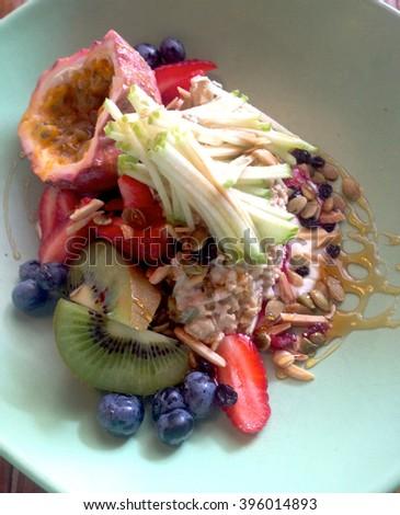 Bircher Museli Breakfast Vignette (Strawberries, Blueberries, Kiwi Fruit, Apple) - stock photo