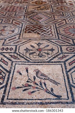 Bird and symbol mosaics inside Basilica di Aquileia in Italy - stock photo