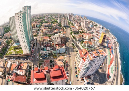 Bird eye aerial view of Havana city capital of Cuba in latina america - Detail of skyscrapers in modern downtown business district - Skyline with fisheye lens distortion and warm saturated color tones - stock photo