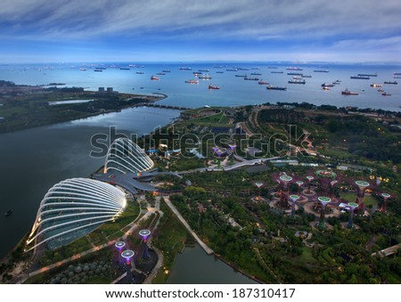 Bird eye of Landscape from bird view of Cargo ships entering one of the busiest ports in the world, over the Garden by the bay in Marina bay sand  - stock photo