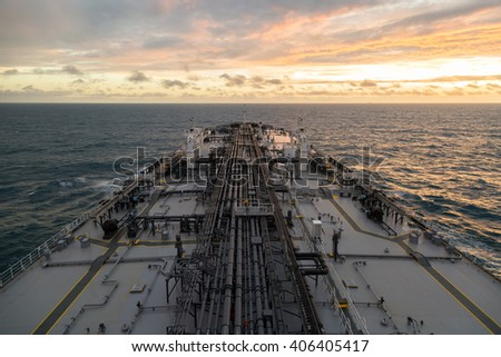 Bird-eye perspective of oil tanker while sunset. - stock photo