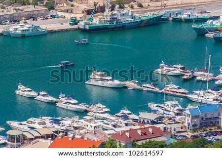Bird-eye view of Balaklava bay with yachts and small ships, Crimea, Ukraine - stock photo