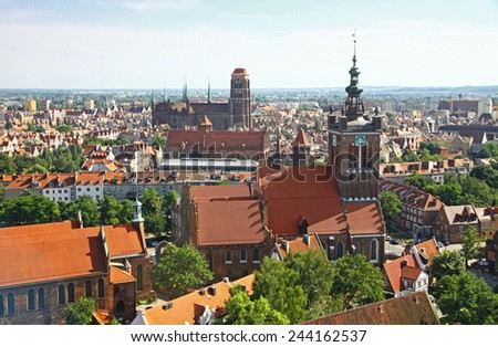 Bird eye view of St. Catherine Church, St. Mary Church and roofs of Gdansk city centre, Poland - stock photo