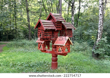 bird feeders in the form of houses in the park - stock photo