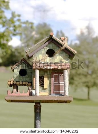 Bird house in the garden - stock photo