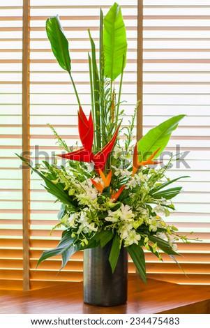 Bird of paradise flower in vase arrangement - stock photo