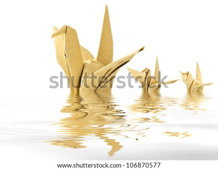 Bird origami  reflected in water. - stock photo