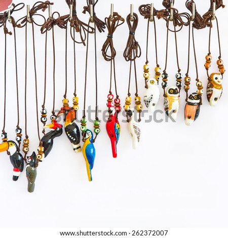Bird Pottery thailand,Clay bird whistle Necklace - stock photo