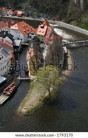 Bird's eye view of medieval houses on the island in the historical center of Cesky Krumlov, Czech Republic. - stock photo