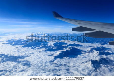 bird's eye view of the himalayas on the plane - stock photo