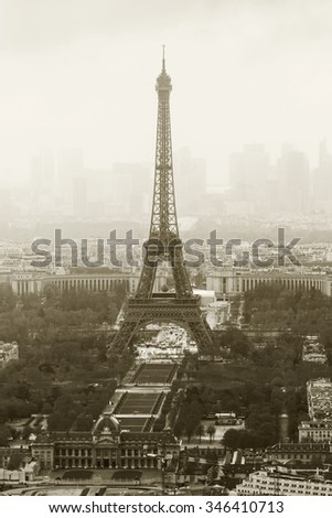 Bird's eye view on the misty Eiffel tower which stands on the Champ de Mars in Paris, France - stock photo