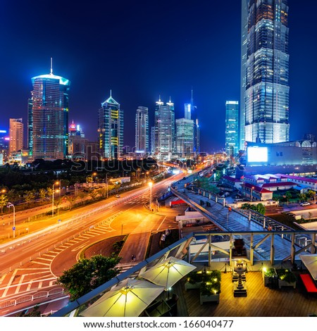 Bird view at Shanghai China. Skyscraper under construction in foreground - stock photo