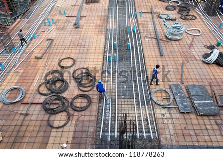 bird-view Construction site with metal and workers - stock photo