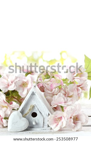 birdhouse and spring flowers - stock photo