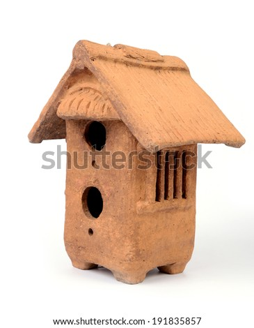 Birdhouse made by clay on white background. - stock photo