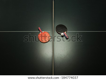 Birds eye view of table tennis table and ping pong paddles. Concept of sports competition - stock photo