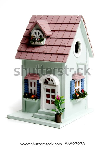 Birds house in the studio against a white background - stock photo