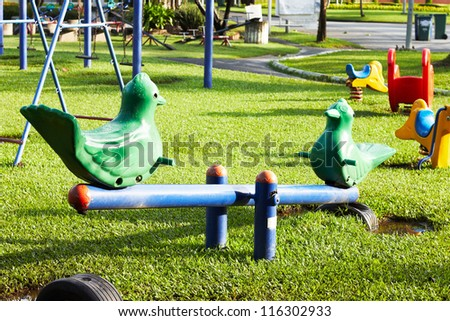 Birds seesaw in the park, playground for kids - stock photo