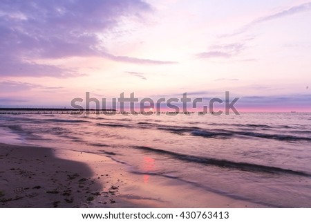 Birds sitting on the breakwater, Baltic Sea, Poland - stock photo