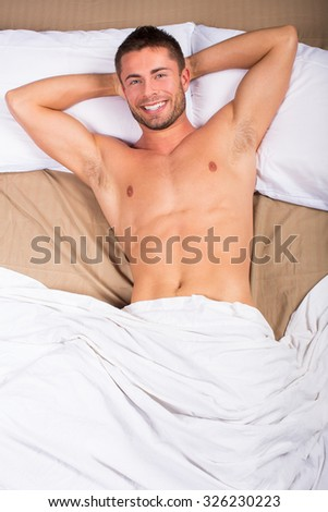 Birdseye view of an attractive man laying in bed - stock photo
