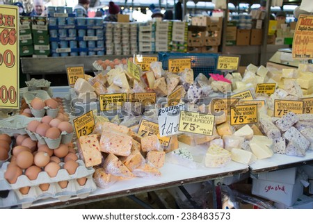 BIRMINGHAM, England - DECEMBER 13: A farmer market selling variety of fruits in Birmingham christmas market, December 13, 2014. Birmingham City, England. Variety of fruits. - stock photo