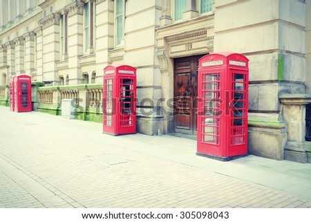 Birmingham red telephone boxes. West Midlands, England. Cross processing color tone - filtered retro style. - stock photo